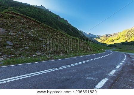 Transfagarasan Road At Sunrise. Popular Travel Destination Of Romania. Beautiful Summer Landscape In