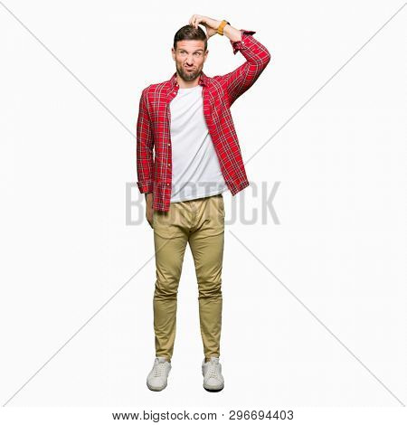 Handsome man wearing casual shirt confuse and wonder about question. Uncertain with doubt, thinking with hand on head. Pensive concept.