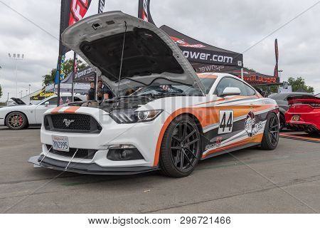 American Muscle Car Ford Mustang Exhibited At Torqued Tour Event.