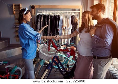 Selling bicycle - Seller woman to selling customers new bicycle in store store