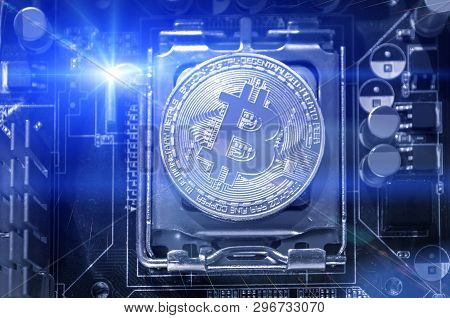 Silver bitcoin on the microprocessor, closeup. Business concept of digital cryptocurrency. Blockchain technology, bitcoin mining concept