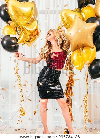 Girls Party. Special Occasion. Beautiful Blonde Lady In Dressy Sparkling Outfit Smiling, Posing With