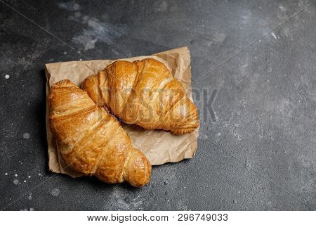 French Croissant. Freshly Baked Croissants With Jam On Dark Stone Background. Tasty Croissants With