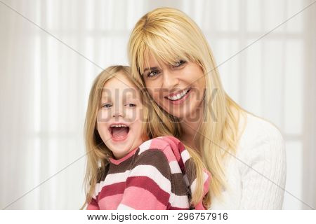 Beautiful smiling woman and girl. Family