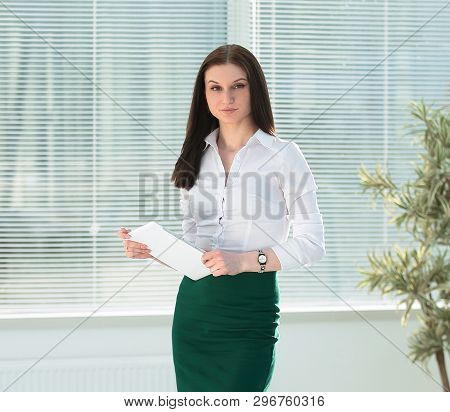 Employee Of A Company With Digital Tablet Standing In A Modern O