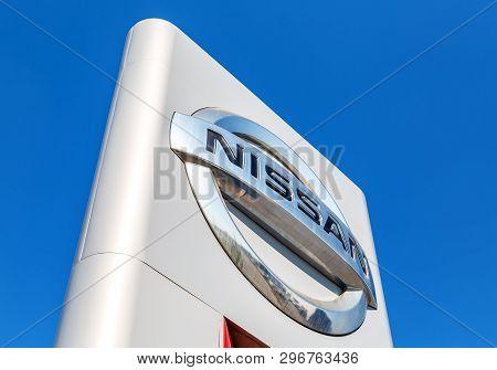 Samara, Russia - April 20, 2019: Nissan Official Dealership Sign Against Blue Sky. Nissan Is A Japan