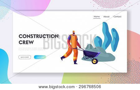 Bearded Worker In Helmet And Orange Uniform Pushing Wheelbarrow On Road Repair Or Building Construct