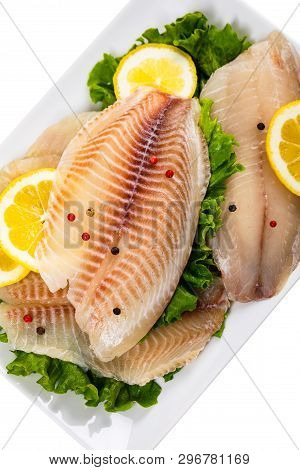 Whitefish Tilapia Fish Raw Fillet Isolated On White. Selective Focus.