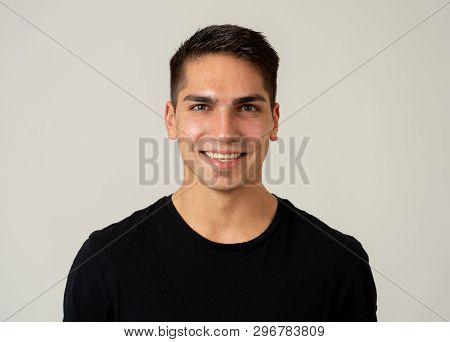 Portrait Of Attractive Cheerful Young Man With Smiling Happy Face. Human Expressions And Emotions