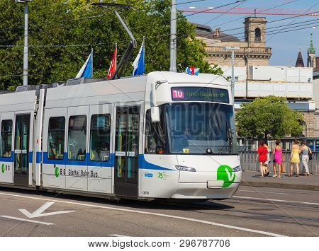 Zurich, Switzerland - August 1, 2018: A Tram Of The Vbg Company Heading To The Zurich Airport Passin