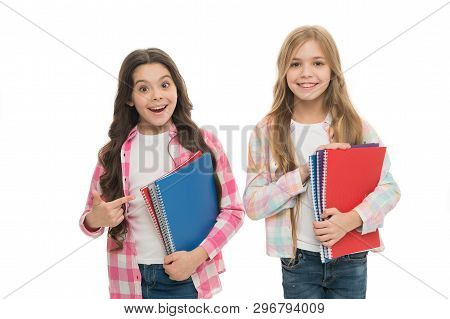 Collection Of Exercise Books Is Ready For The School Term Ahead. Cute Small Children Holding Note Bo