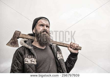 Handsome Man Hipster Or Guy With Beard And Moustache On Serious Face In Hat And Jacket Holds Rusty A