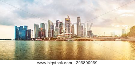 Singapore Business District Skyline During Sunset. Group Of Skyscrapers At Marina Bay, Singapore.