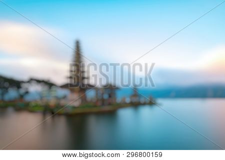 Out Of Focus Of Ulun Danu Beratan Temple Is A Famous  Landmark Located On The Western Side Of The Be