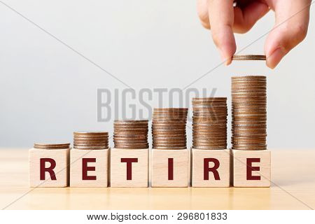 Hand Putting Coins On Stack Stair As Step Growing Growth And Wooden Cube Block With Word Retire. Mon
