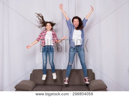 Girls Only. Mom And Daughter Close Friends. Mother And Cheerful Daughter Having Fun Jumping Couch. H