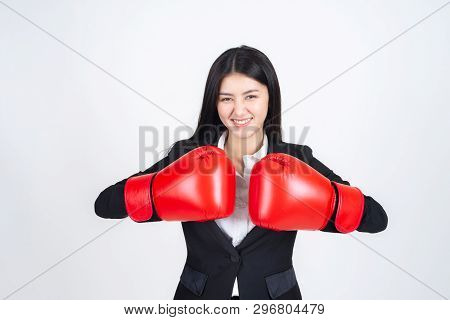 Beautiful Asian Business Young Woman  Wearing A Boxing Glove In Hand And Business Suit , Winning Suc