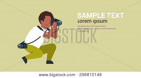 man professional photographer taking photo african american guy journalists or paparazzi taking photos using dslr camera horizontal full length flat copy space poster