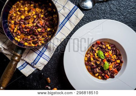 Chili Or Chilli Corn Carne. Cooked Kidney Bean, Minced Meat, Chili, Corn And Pepper In White Bowl  O