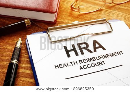Health Reimbursement Account Hra With Clipboard On Desk.