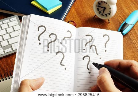 Making Decision And Uncertain Concept. Question Marks In Note.
