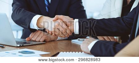 Business People Shaking Hands At Meeting Or Negotiation In The Office. Handshake Concept. Partners A