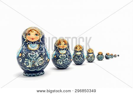 Matryoshka Dolls Isolated On A White Background. Russian Wooden Doll Souvenir. Russian Nesting Dolls