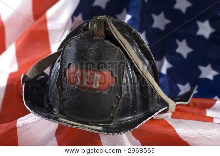 Firefighter Helmet On American Flag