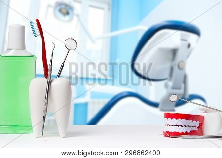 Dental Health And Teethcare Concept. Dental Mirror With Explorer Probe And Toothbrush In White Tooth