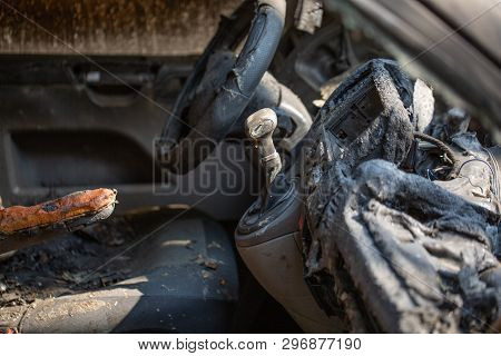 Inside View Of Burnt Out Wreckage Of A Stolen Car. Crime Scene Image Of Vehicle Interior Ruined By F