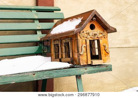 Wooden Bird House Shelter On Bench In Cold Weather Snow