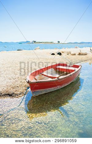 Pakostane, Croatia, Europe - A Red Rowing Boat At The Beach Of Pakostane
