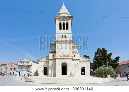Pakostane, Croatia, Europe - August 27, 2017 - Tourists Walking Around The Church Steeple Of Pakosta
