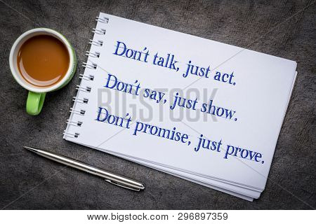 Don't talk, just act. Don't say, just show. Don't promise, just prove. Motivational handwriting in an art sketchbook with a cup of coffee.