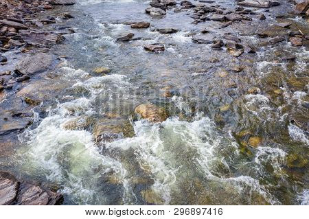 view of a shallow rapid on a mountain river - Poudre River in northern Colorado