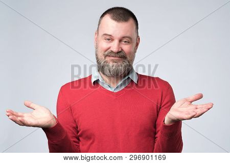 Man Showing I Have No Idea Gesture, Shrugging Shoulders And Raising Hands