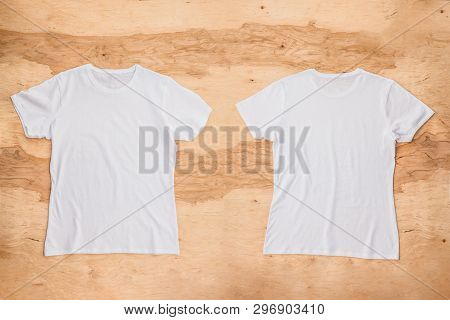 Front And Back Of White Empty T-shirt On Wooden Background. Horizontal View.