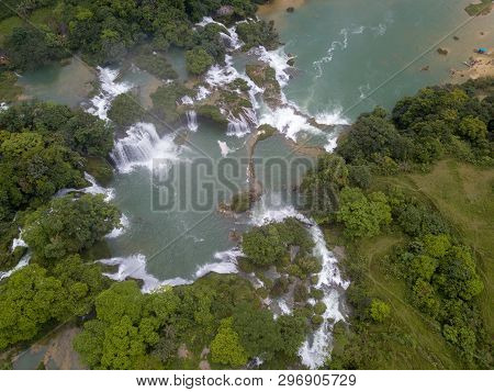 Ban Gioc waterfall or Detian waterfall is a collective name for two waterfalls in border Cao Bang, Vietnam and Daxin County, China. Royalty high-quality free stock photo image of a beautiful waterfall poster