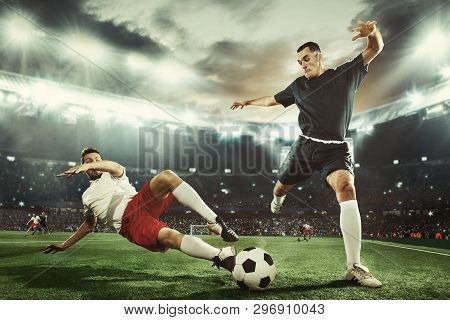Two Caucasian Fit Active Men As Soccer Players Fighting With Ball At Stadium. Game Concept. Competit