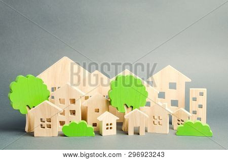 Miniature Wooden Toy Houses And Trees. Real Estate Concept. Architecture In The City. Infrastructure