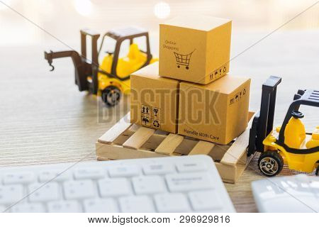 Mini Forklift Truck Load Cardboard Box With Text Online Shopping And Symbols On Wood Pallet And Keyb