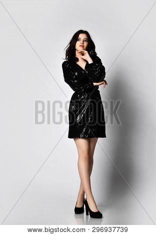 Young Beautiful Brunette Woman In Black Modern Spring Jacket Dress Full Body Posing On Gray Backgrou