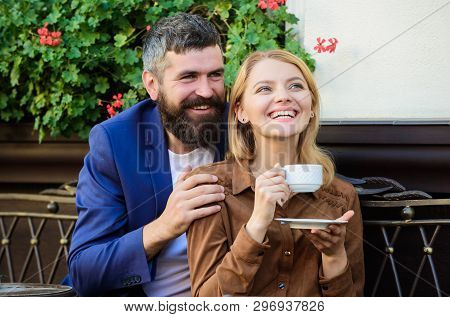 Couple In Love Sit Hug Cafe Terrace Enjoy Coffee. Pleasant Family Weekend. Explore Cafe And Public P