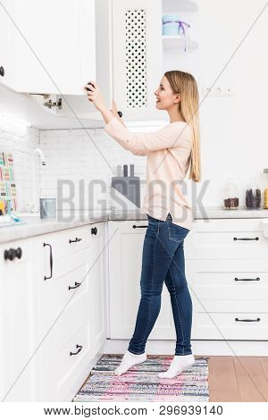 Female hand open the cupboard doors, close up poster