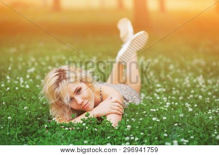 Attractive Beautiful Young Blonde Woman Outdoors Enjoy Summer Nature. Cheerful Healthy Smiling Girl
