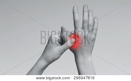 Young Woman Suffering From Pain In Palms, Massaging Her Painful Hand From Symptoms Of Peripheral Neu