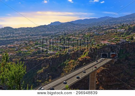 Aerial View At Funchal From Monte With A Freeway Bridge In Foreground. Portuguese Island Of Madeira