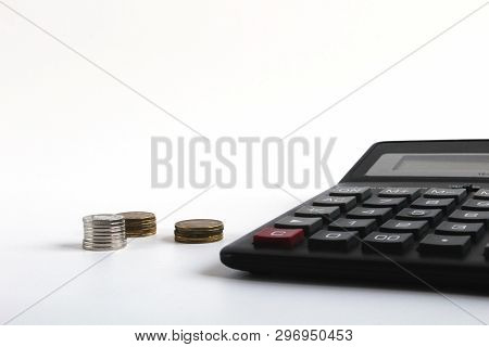 Financial Accounting, Money Calculator On Table. Business, Finance, Saving Money, Taxes, Accounting