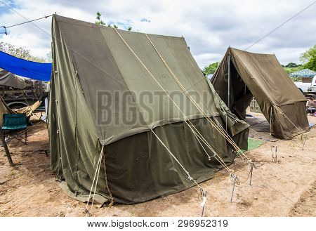 Two Old Green Khaki Military Pitched Tents poster