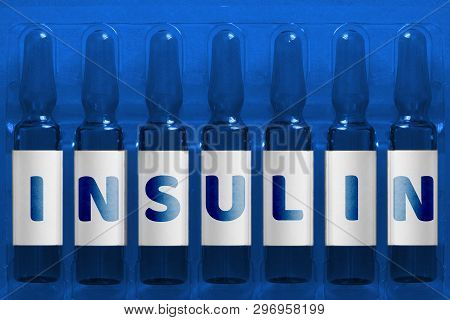 Diabetes Problems Concept Image. Seven Ampules With Overlay Letters Of Inscription I N S U L I N